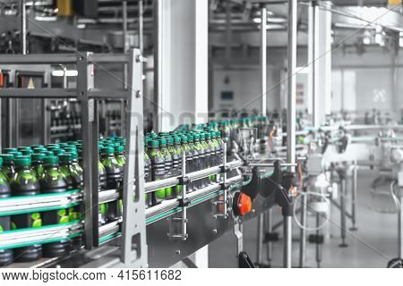 Industrial Beverage Factory Interior With Automated Computerized Conveyor Line Or Belt And Plastic B