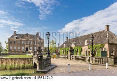 Ommen, Netherlands - April 27, 2020: Bridge Leading To The Historic Eerde Castle In Ommen, Netherlan