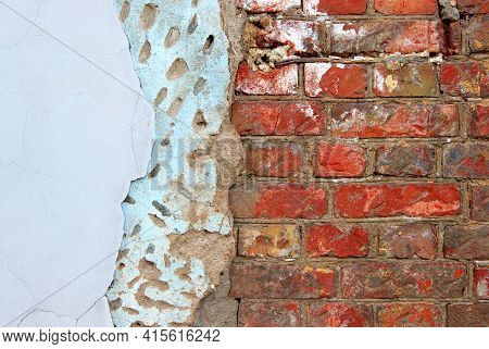 An Old Damaged Brick Wall Partially Covered With Two Layers Of Plasterwork As A Background