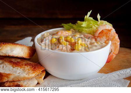 Bowl Of Homemade Corn Chowder Soup With Potatoes, Carrots And Shrimp.english Shrimp Chowder Soup