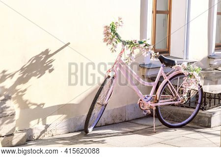 Street Decor, City Beautification, Pink Vintage Retro Bike Decorated With Flowers Stands By The Wall