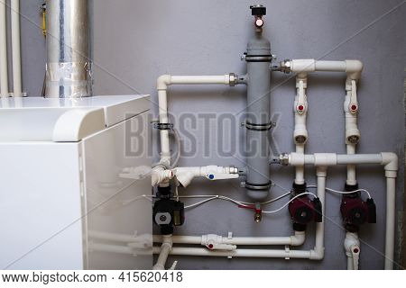 Heating System Of A Private House, Boiler Room With Gas Equipment, Water Pipes. Dispensing Vessel Co