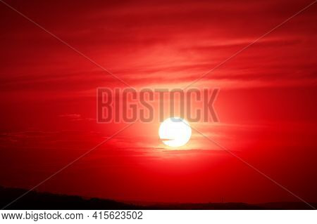 Bloody Sky With Spectacular Sunset . Big Sun Over The Horizon In The Evening