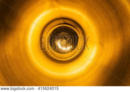 Metal Lampshade. Ceiling Lamp Isolated On Black. Bright Glass Light Bulb. Light Background. Round Sh