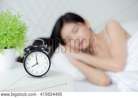 Beautiful Young Asian Woman Sleep With Relax On The Bed With Alarm Clock In The Morning, Girl Sleep
