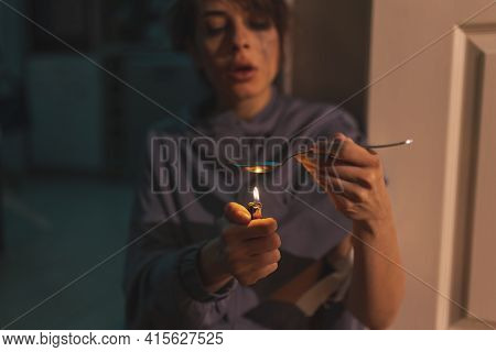 Junkie Sitting On The Floor In The Dark, Preparing Next Intravenous Cocaine Dose, Using A Lighter An