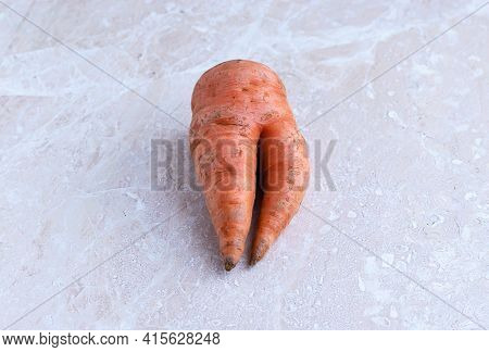 Fashionable Ugly Organic Carrots From Home Garden On Light Surface. Selective Focus. Place For Your