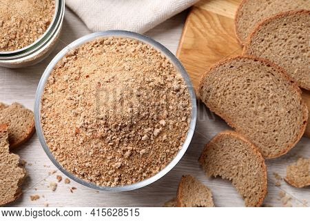 Fresh Breadcrumbs On White Wooden Table, Flat Lay
