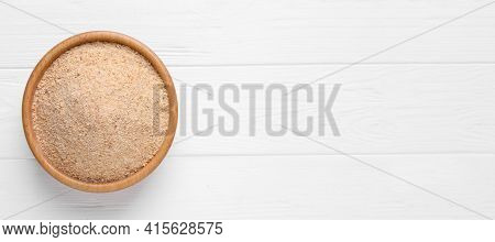 Fresh Breadcrumbs In Bowl On White Wooden Table, Top View. Space For Text