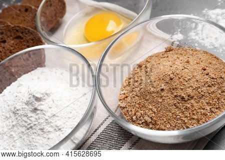 Fresh Breadcrumbs, Flour And Egg On Table, Closeup