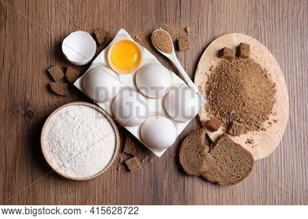 Fresh Breadcrumbs, Flour And Eggs On Wooden Table, Flat Lay