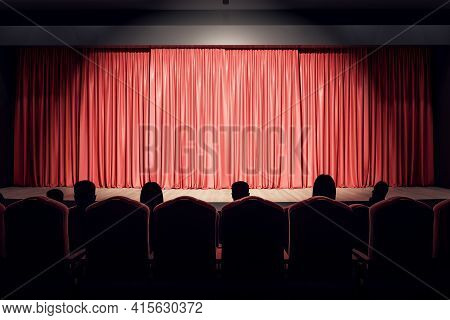 Projector Light On Red Backstage With Copyspace In Performance Hall And Spectators On Seats. 3d Rend
