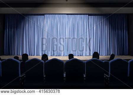 Projector Light On Blue Backstage With Copyspace In Performance Hall And Spectators On Seats. 3d Ren