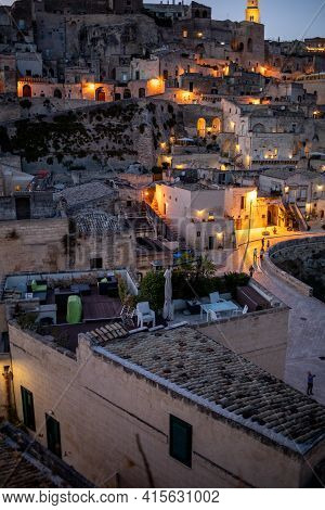 Matera, Italy - September 20, 2019: Evening View Of The City Of Matera, Italy, With The Colorful Lig