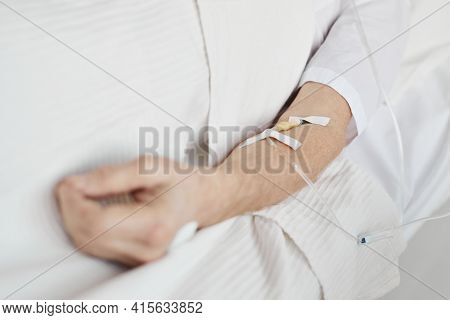 Close Up Of Iv Drip Tubes And Catheter In Hand Of Unrecognizable Senior Man, Copy Space