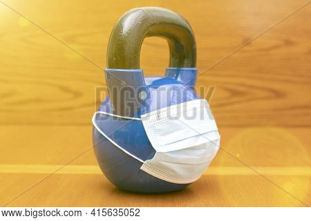 Kettlebells On Gym With Blue Surgical Mask. Close Up. Sports Kettlebell In The Gym, Top View. Kettle