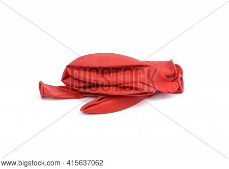 Pile Of Deflated Rubber Red Balls Isolated On White Background, Close Up