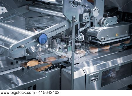 Automatic Packing Of Bakery Product Flow Pillow Packing Machine. Bread, Toast, Bun Plastic Wrapping