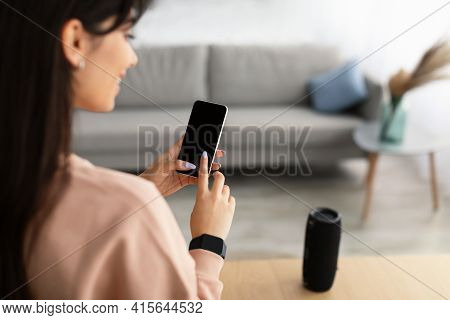 Back View Of Woman Using Phone With Empty Mockup Screen