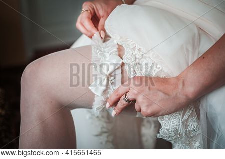 Bride Wearing Wedding Garter On The Leg
