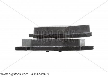 Brake Pads One On Top Of The Other Demonstrate The Thickness Of Asbestos Abrasive Alloy, New Car Spa