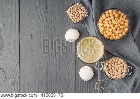 Flat Lay With Tasty Meringues, Aquafaba And Chickpeas On Grey Wooden Table, Space For Text. Egg Subs