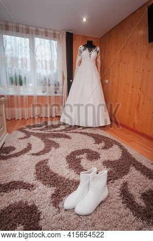 White Wedding Dress And Pair Of White Shoes