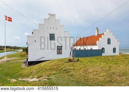 Historic building of Limfjordsmuseet between Frederik VII's canal and Limfjord inlet at Løgstør, Denmark