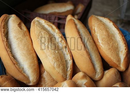 Traditional Crusty French Bread Baguette In Basket At Bakery.