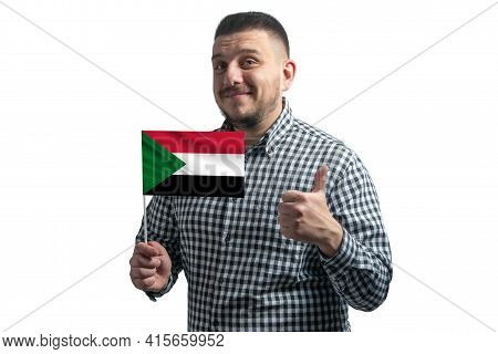 White Guy Holding A Flag Of Sudan And Shows The Class By Hand Isolated On A White Background. Like F