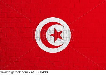 Flag Of Tunisia. Brick Wall Texture Of The Flag Of Tunisia.