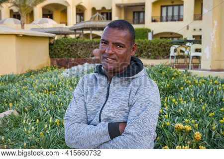Portrait Of A Smiling Dark-skinned Man Of 40 Years On The Background Of Beautiful Buildings, Close-u