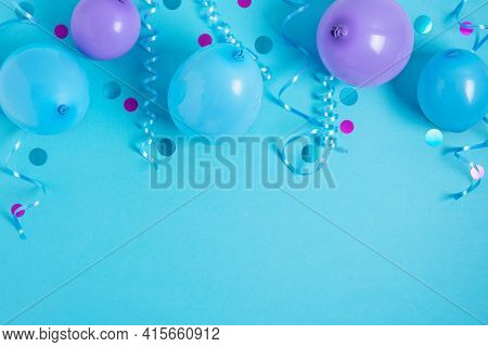 Party Background With Balloons, Streamers And Confetti On Pastel Blue Background. Birthday Party Dec