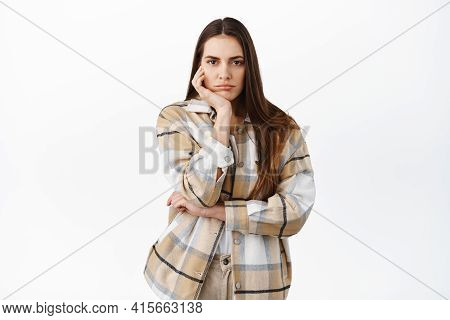 Sad Or Bored Woman Stare Indifferent At Camera, No Emotions Poker Face, Lean Head On Palm And Lookin