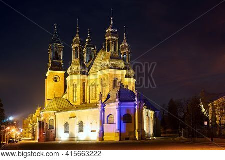 Gothic, Historic Cathedral With Towers During The Night In Poznan