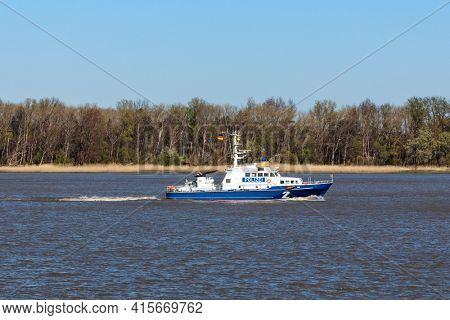 Stade, Germany - April 22, 2020: German police patrol boat BÜRGERMEISTER WEICHMANN on Elbe river heading  to Hamburg