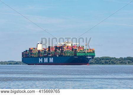 Stade, Germany - Juy 31, 2020: HMM Dublin, with it's sister ships the largest container vessel in the world .