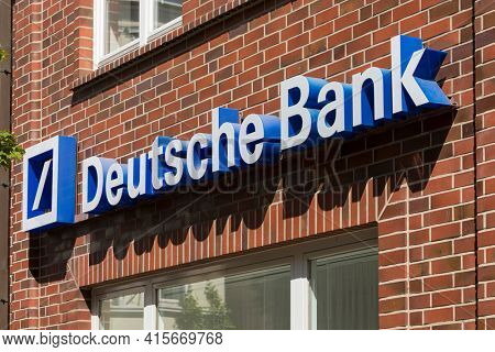 Stade, Germany - May 28, 2020: Signage on brick wall at Deutsche Bank branch. Deutsche Bank is a global Multinational Investment bank and financial services company headquartered in Frankfurt, Germany