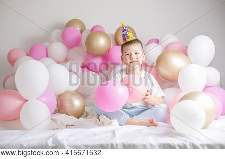 Little Boy In White Balloons . Small Child With Party Balloons, Celebration. Birthday, Happiness, Ch