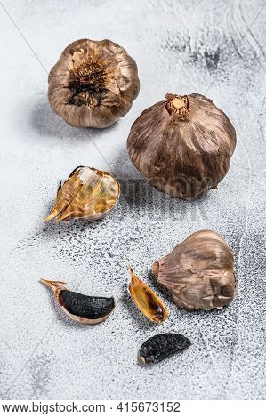 Whole Balsamic Fermented Black Garlic. White Background. Top View