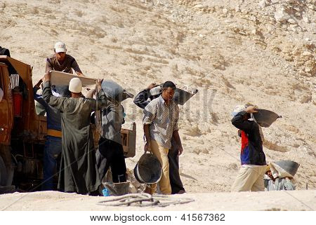 Unidentified men work for excavation of tombs