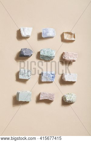 Many Crystal Minerals On Beige Background. Magic Rock For Crystal Ritual, Witchcraft, Spiritual Prac
