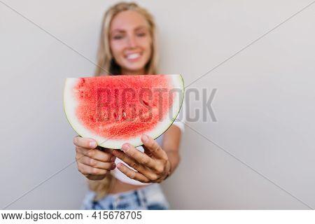 Blur Portrait Of Emotional Blonde Girl Holding Slice Of Watermelon. Enchanting Fair-haired Lady Enjo