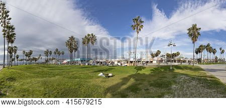 Venice, Usa - March 5, 2019: People Enjoy Scenic Beach Promenade With Palms And Colorful Houses At V