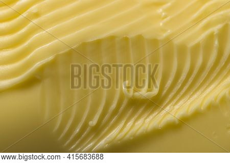 Super Close Up Macro Background Of Intricate Grooves And Swirls Of Margarine. Made By A Serrated Kit