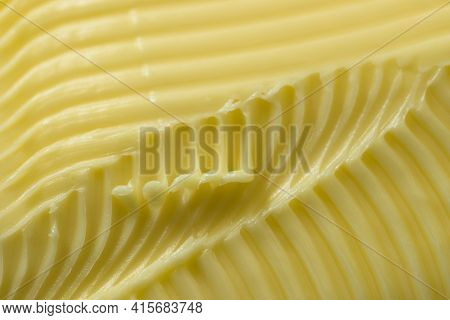 Close Up Of Yellow Butter. Full Frame Textured Background, With A Super Macro Perspective. Serrated