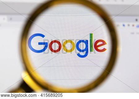 Moscow, Russia - 31 March 2021: View The Google Homepage Through A Golden Magnifier, Company Logo. H