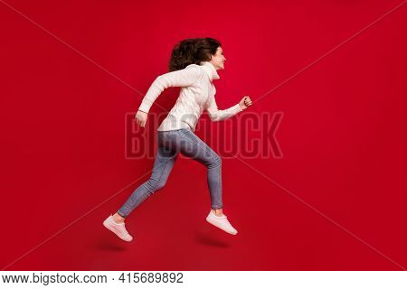 Full Length Photo Of Cute Purposeful Young Lady Wear Collar Pullover Jumping High Running Isolated R
