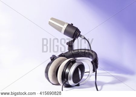 Professional Condenser Microphone And Headphones On White Background, High Key Portrait, Selective F