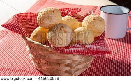 Cheese Bread, Basket Lined With Red And White Fabric Filled With Cheese Bread On A Checkered Towel A